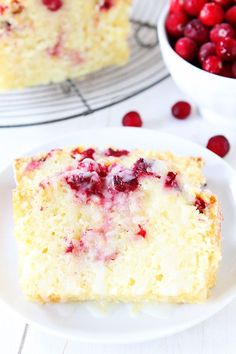 Orange Cranberry Bread Recipe on twopeasandtheirpod.com Sweet orange bread dotted with cranberries and drizzled with an orange glaze! This bread is perfect for holiday parties, meals, and makes a great gift too!