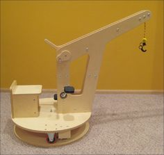 This Instructable is for building a kids toy crane. I call it a toy, but it is really a heavy duty machine for a kid of any age. I designed this crane for my son who was a crane fanatic at the time. The crane is built mostly from wood and uses various screws, nut, bolts, caster wheels, and a variety of other parts. I will try to give as much information as possible so you can build something similar. Believe me that your kids are going to love this thing. It may take s...