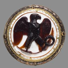 An ancient Roman onyx cameo, 27 BC, depicting the imperial eagle, symbol of Rome's power (and Jupiter's attribute), holding a palm branch, symbol of victory, and oak wreath (corona civica), symbol of glory; it marks the honour given to Octavian who delivered Romans from civil war, and signifies that he was under the protection of Jupiter. (Kunst Historisches Museum Wien)