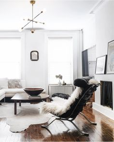 minimalist modern living room with leather chair + sheepskin