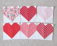 After seeing so many adorable heart quilts over the past couple of years I finally started my own this week. I have so many random sized pieces of reds and pinks that I'm ready to use up…so a heart qu