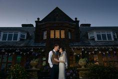 Pickwell Manor wedding photo lit with magmod to light them against the dark building