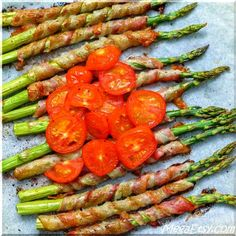 Bacon wrapped baked asparagus covered with some tomato slices - perfect and healthy