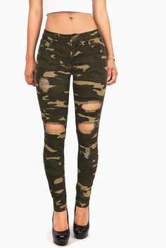 Mid-rise skinny jeans with a worn in camo print, distressed ripped design…