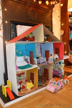 Little Girls and Their Doll's Houses via www.lifeatthezoo.com