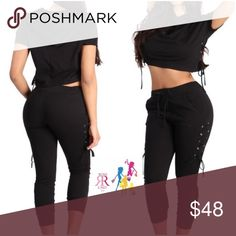 Charlie 2Pc Jogger Set Short Sleeve sweat Set with hooded cropped Top and jogger pants bottom.  Lace Up ribbon tie eyelet buttons Accent on the sides. Color: Black; Sizes: S(0/2), M(4/6), L(8/10) Pants Jumpsuits & Rompers