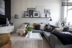 Grey living room: love the frame display