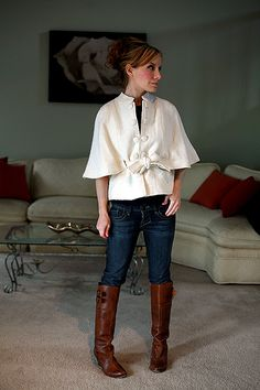 ivory capelet and leather boots