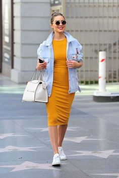 Olivia Culpo spring style with denim jacket, yellow dress and sneakers (April 2017). #ootd #outfit #oliviaculpo #denimjacket #fashion #fabfashionfix #spring