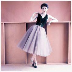 Model in sleeveless black jersey evening blouse and tulle and taffeta dancing skirt, 1952. Photo by Richard Rutledge.