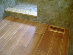 Master #Bathroom | Quartz Threshold, Porcelain Wall & Floor Tiles to Mimic Slate and Hardwood with Custom Stain Matched Wood Register Cover