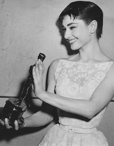 """Photographed with her Best Actress Oscar for """"Roman Holiday"""", 1954"""