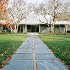 The pathway from the pool to the house is paved with the same slate that clads the exterior walls.  Photo by Leslie Williamson.