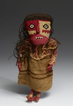 Peruvian Grave Doll, made by the Pre- Incan Chancay people.  The climate and soil of Peru is ideal for preserving buried grave goods.  Chancay (Artist)  PERIOD  1000-1450 (Late Intermediate)  MEDIUM  cotton, wool, wood	  (Textiles)