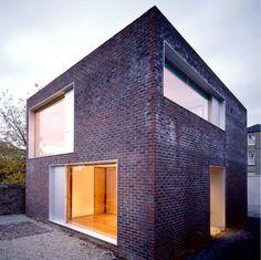 Brick facade with pressed metal window reveals