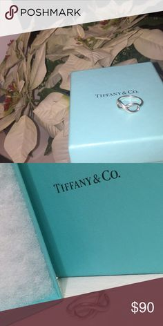 Beautiful Tiffany Infinity Ring in sterling silver Comes with the Tiffany box. It was A gift and It has been worn previously by my daughter in-law for 24 hours. Just not her taste. Not a scratch on It. Still with the shine. Have receipts for proof of purchase. Tiffany & Co. Jewelry Rings
