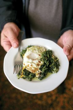 Wild Greens with Fried Eggs (Horta me Avga Tiganita) - This dish from Epirus marries the silky richness of an egg with the pleasing, mild bitterness of wild greens.