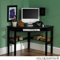 """This quaint little desk offers a great work space and lower shelving on two sides. The drop-down keyboard tray doubles as laptop storage, and a cord grommet keeps wires tidy. Its dimensions are 48"""" W"""