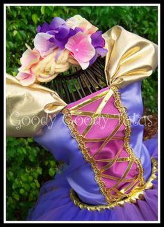 Rapunzel costume, handmade on Etsy... this one made my heart skip a bit...