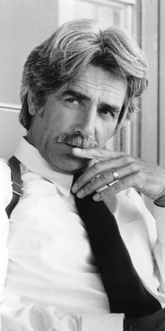 """Samuel Pack """"Sam"""" Elliott (born August 9, 1944) is an American actor. His rangy physique, thick horseshoe moustache, deep, resonant voice and Western drawl lend to frequent casting as cowboys and ranchers. He is also the voice behind numerous commercials."""
