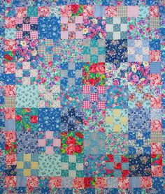 Floral scrap quilt, nine patch, by peskybombolino. Started in 2001 at a workshop with Kaffe Fassett, completed 2008!