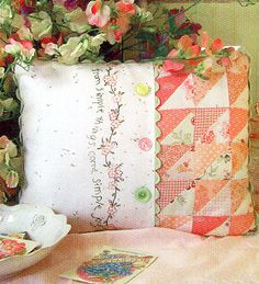 Simple joys of spring pillow -- I have a similar printed fabric that I have been wondering what I would do with -- problem solved!