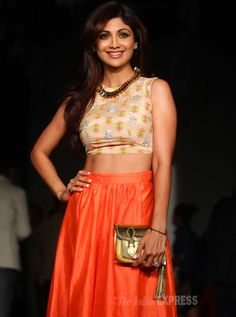 Meanwhile a host of celebs cheered for their favourite designers.  #ShilpaShetty was her usual sultry self in the black skirt and embroidered choli-top. (IE Photo: Dilip Kagda) #LFW14