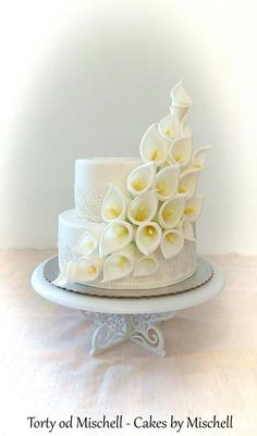 Simple calla lily wedding cake by Mischell - http://cakesdecor.com/cakes/272308-simple-calla-lily-wedding-cake