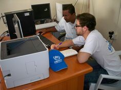 UN Volunteer Guillaume Fardel discusses registration challenges for Somali and Ethiopian refugees and asylum-seekers with UNHCR personnel in Mayfa's Registration Centre on the Arabian Sea coast. (UNHCR, 2008)