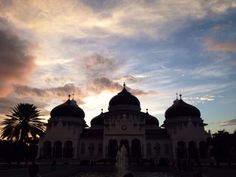 Silhouette of the al-masjid al-baiturrahman (prophet's mosque) at sunset in Banda Aceh-Indonesia