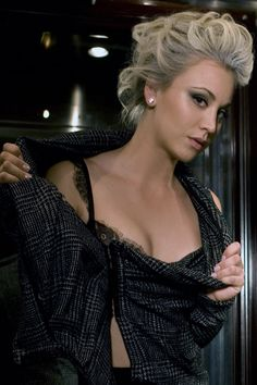 Kaley Cuoco channels her inner material girl in this sexy photoshoot featuring an all black look. The black eyeshadow, lace bralette, and plaid shirt look red-hot! Her vintage updo completes the look. The Big Band Theory, Big Bang Theory, Dbz, Kaley Cuocco, Vintage Updo, All Black Looks, Eyeshadow Looks, Material Girls, Lace Bralette