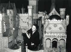 Celluloid star: Built in 1928, the Fairy Castle was the property of the famous silent movie actress Colleen Moore (pictured crouching in its courtyard)