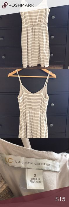 LC Lauren Conrad Tan & White Striped Dress Cute LC Lauren Conrad spaghetti strap dress in tan and white stripes with ruched bodice on back. This dress is really comfy and I love that it has pockets! LC Lauren Conrad Dresses Mini