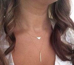 Minimalist triangle necklace in your choice of solid 14k yellow, rose or white gold MAIN FEATURES ~Solid 14k gold ~10mm length ~sturdy cable chain ~spring clasp ~made in the USA ~packaged for gifting More unique styles here-->https://www.etsy.com/shop/KelleyAnneJewelry  Our current production time is between 7-10 business days, Once complete domestic packages will be shipped via FedEx 3 day delivery with signature confirmation for your protection International packages will be shipped via…