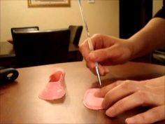 Fondant cake decorating - how to make baby shoe cake topper - YouTube