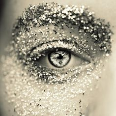 a basic representation of what happens when I attempt to wear glitter eyeshadow. Minus the eyebrow. Although not a bad way to disguise the fact that I managed to lop half of it off with a razor.