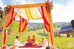 I like the simple mandap with draping (different colors)
