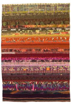 Terra Australis by Dianne Finnegan 1988 Colours of Australia stratified with weathering patterns of a rock face. 230 cm by 160 cm (90 1/2 in x 63 in) Silks, cotton etcetera, machine pieced and quilted