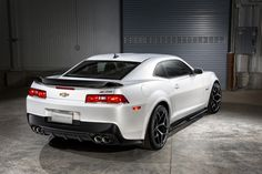 """The 2014 Camaro Z28. As the ultimate track-capable Camaro, this car restores the mission of the original Z/28, and serves as a testament to the expertise of Chevrolet as the best-selling brand of performance cars,"""" said Mark Reuss, president, GM North America."""