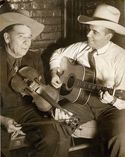 """Bob Wills and with his father, the champion fiddler known as """"Uncle John,"""" in the mid-1940s. Photography courtesy www.bobwills.com"""