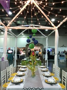 Columbus Bride: The Show Chevron table: White chiavari chairs, white poly linen, grey chevron printed runner, yellow & grey chevron printed napkins, grey charger plates, Spriale china, Pure glassware, & Lucca flatware. Floral design provided by The Avant Garden.