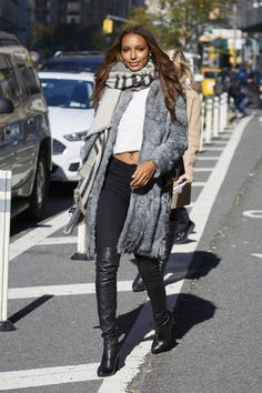 12 chic winter outfit ideas to inspire your look this season: Jasmine Tookes in a gray fur jacket and oversized scarf