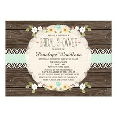 BEAUTIFUL FLORAL RUSTIC BOHO STYLE BRIDAL SHOWER INVITATIONS WITH A PRINTED MINT, PALE GREEN AND JADE HUED RIBBON WITH A CREAM WHITE PAPER CUTOUT LOOK LACE DESIGN AND SHEER LOOK PAPER DOILY ON A WOOD FENCE WOOD GRAIN OR BARREL LOOK BACKGROUND WITH NAIL HEAD TRIM. THE FLORAL DESIGN IS MADE UP OF PRETTY TEAL BLUE WILD ROSE POSY TULIP, YELLOW SUNFLOWER AND BROWN EYED SUSAN DAISIES AND WHITE CHERRY BLOSSOM BRANCHES AND BERRY LAUREL. THIS CHARMING DESIGN IS PERFECT FOR A BOHEMIAN CHIC COUNTRY ...