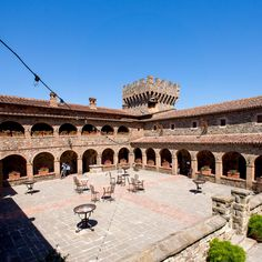 #blue sky #bricks #castello di amorosa #castle #court #patio #summer #tables #tower #villa 4k