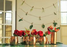 pick a theme for arranging food, such as using vintage serving platters; swapping a nontraditional material, like wrapping paper, for a tablecloth; or introducing a musical theme, with sheet music as a place setting. Place Settings, Table Settings, Copper Mugs, Colorful Party, Spice Jars, Serving Platters, Holiday Parties, Entertaining, Traditional