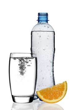 Poster of bottle of water with orange slice and glass, Food Posters, #poster, #printmeposter, #mousepad, #tshirt