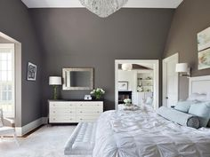 A restful color scheme doesn't have to be a snooze. Focusing on two main colors — gray and white — in various hues makes this contemporary bedroom comfortable and inviting. Sprinkling a variety of textures throughout keeps it interesting, while the fresh flowers add softness and life. Design by Claire Paquin
