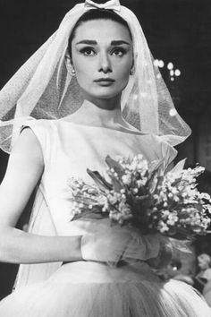 Meghan Markle wore a Givenchy wedding dress for the royal wedding. The look is reminiscent of Audrey Hepburn, an original Givenchy muse. Vestido Audrey Hepburn, Robes Audrey Hepburn, Audrey Hepburn Wedding Dress, Audrey Hepburn Funny Face, Style Audrey Hepburn, Audrey Hepburn Pictures, Movie Wedding Dresses, Wedding Movies, Wedding Dress Styles