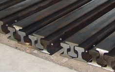 I bet I could weld up some railroad track into cool handrails for the front porch or deck...
