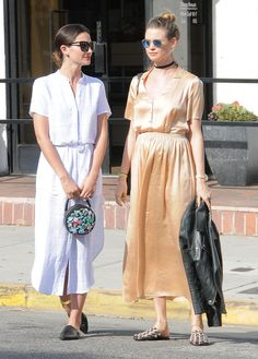 Behati Prinsloo and Lily Aldridge in their Spring midi dress.